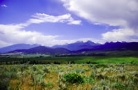 A landscape scene of grasslands, farms, forests, and mountains in the Grand Ronde and Powder River watersheds in eastern Oregon.