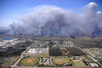 An aerial view of a prescribed burn next to an urban area.