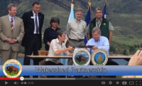 Scene from the video showing DOI Secretary Jewell signing an agreement with USDA Secretary Vilsack.